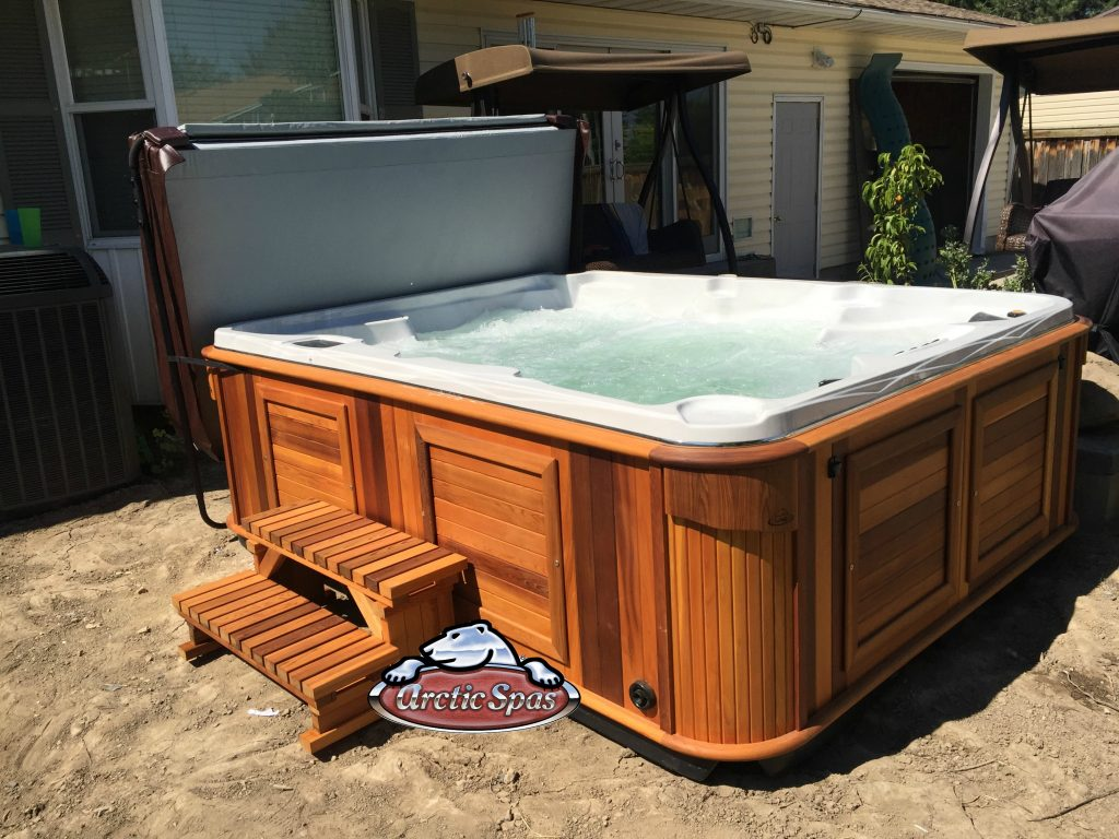 Side view of an Ables family new Arctic Spa Summit XL