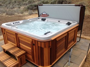 Brock's new Arctic Spas hot tub in red cedar cabinet