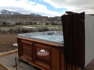 Brock's new Arctic Spa hot tub in red cedar cabinet