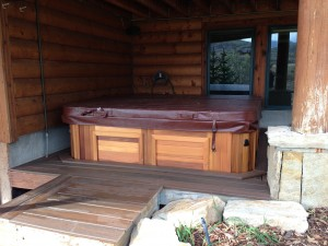 Chamberlain's new Arctic Spas hot tub in red cedar cabinet