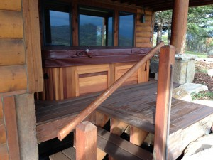 Chamberlain's new Arctic Spas hot tub in a red cedar cabinet
