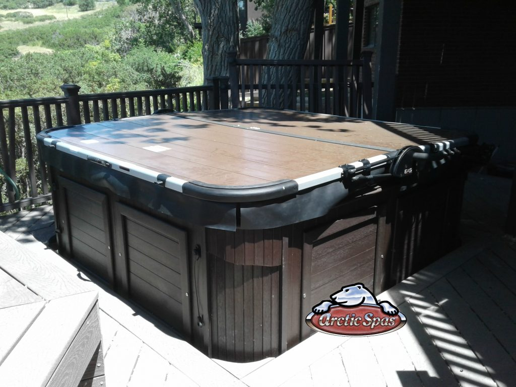 Cionni family new Arctic Spa Yukon with a cover