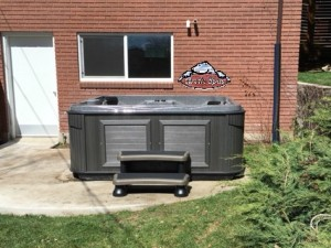 Firszt's new Arctic Spas Frontier in Dakota Granite with a Charcoal Cabinet