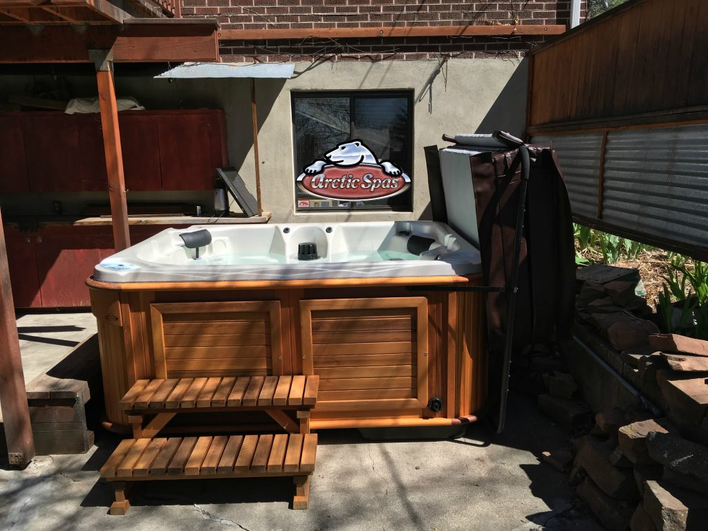 Giles new Arctic Spa Fox in Half and Half Granite with a Red Cedar Cabinet