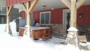 Phillip Arctic Spas Summit XL in Platinum with Red Cedar Cabinet.