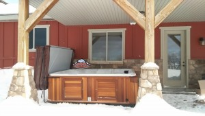 Phillips new Arctic Spas Summit XL in Platinum with Red Cedar Cabinet.