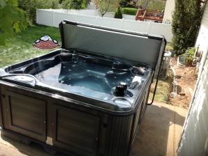 Isacson's new hot tub Yukon in Midnight Opal with the Charcoal Cabinet
