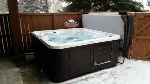 Manning's new Arctic Spas Summit in Platinum with Composite Cabinet in Sable Brown