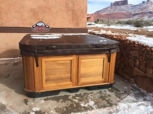 Marquardt's new Arctic Spas hot tub Cub in Kalahari Granite with a Red Cedar Cabinet