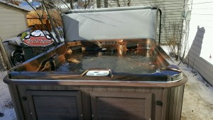 Odom's Arctic Spa Frontier in Mayan Copper with a Sable Composite Cabinet