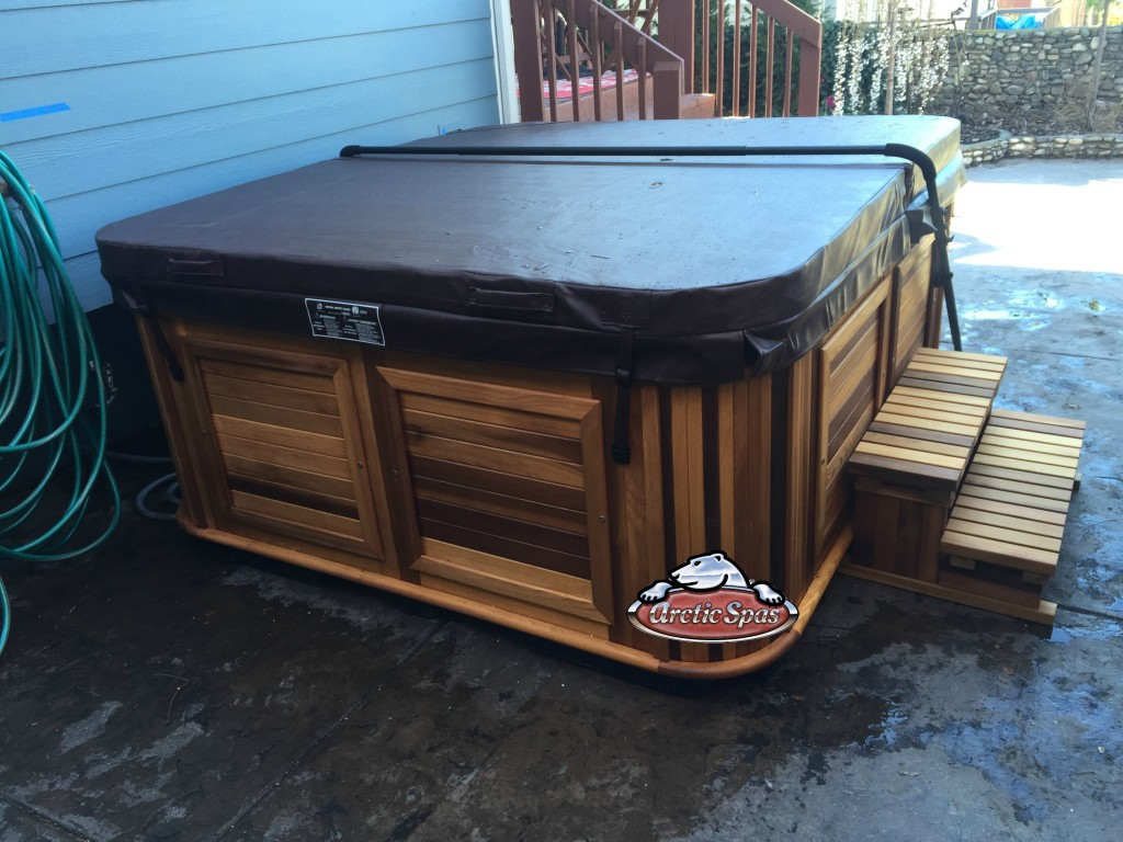 Schwartzmann's new Arctic Spas Frontier in Ocean Wave and Red Cedar Cabinet