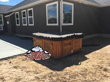 Temlyn's family new covered Arctic Spa Yukon with a cedar red cabinet