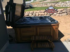 Temlyn's family new Arctic Spa Yukon in Midnight Opal with a cedar red cabinet