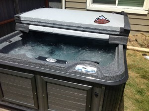Vawdrey new Arctic Spas Cub in Dakota Granite with a Charcoal Composite Cabinet