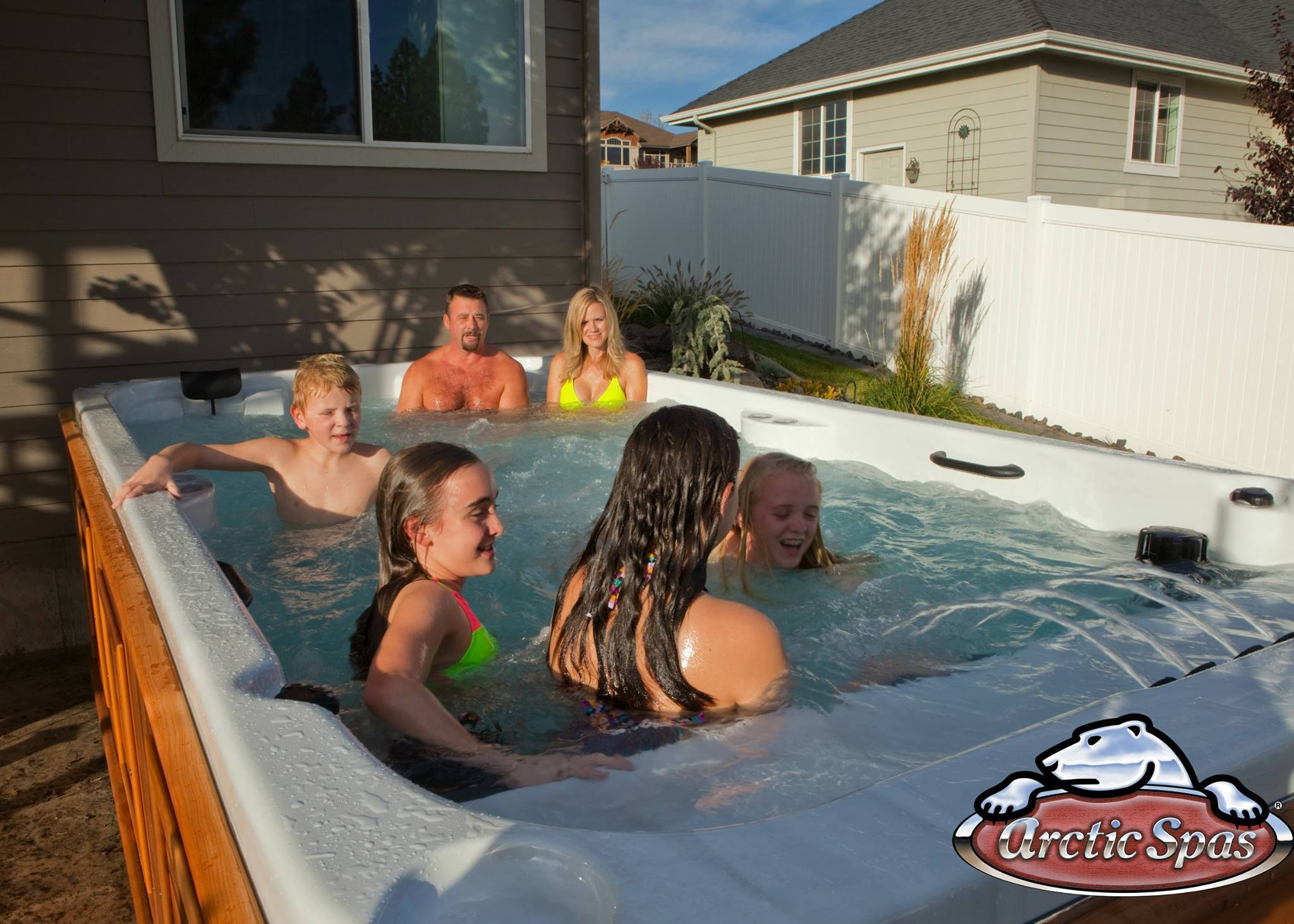 Family having fun in an Arctic Spas All Weather Pool